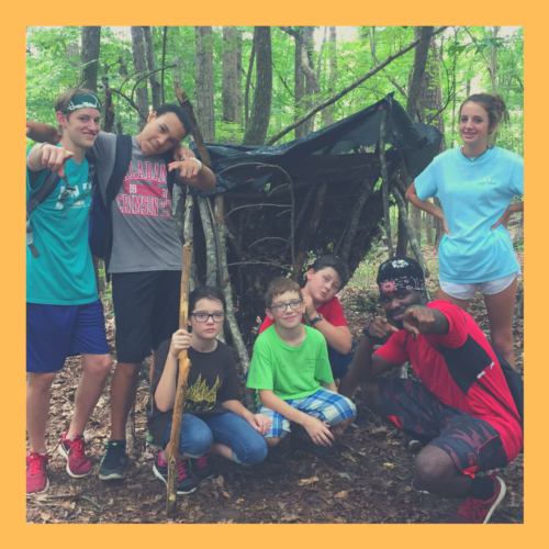 Campers with the shelter they built