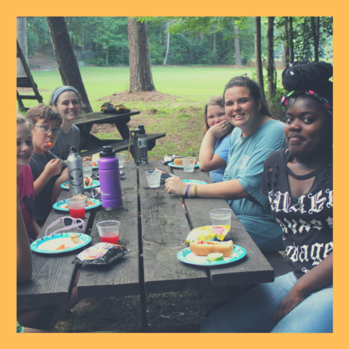 Campers at a supper cookout