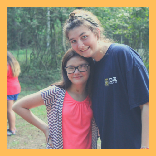 A camper and her counselor
