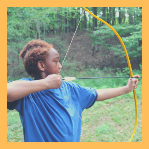 A camper learns archery for the first time.